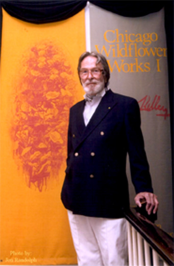 Chapman Kelley in front of Chicago Wildflower Works Banner
