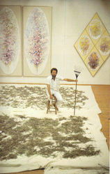 Kelley in his studio with bluebonnet seed collected from DFW Airport,